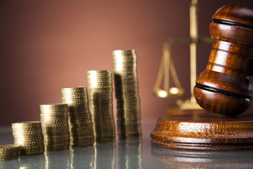Scales of justice and gavel, gold coins
