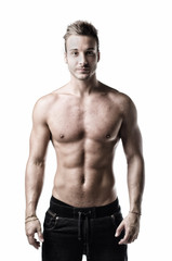 Muscular, friendly young man standing, shirtless