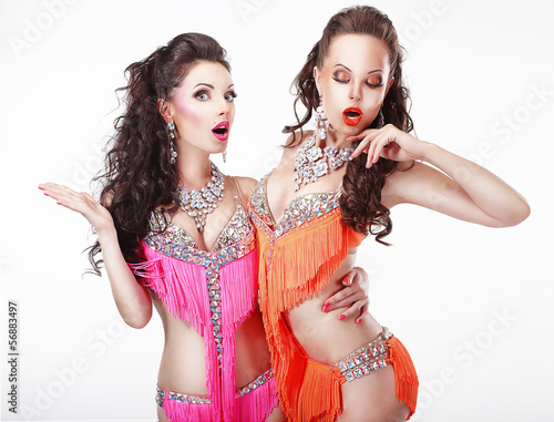 Clubbing. Two Women Showgirls in Stage Dresses