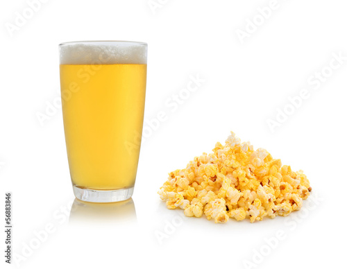 A glass of beer with popcorn