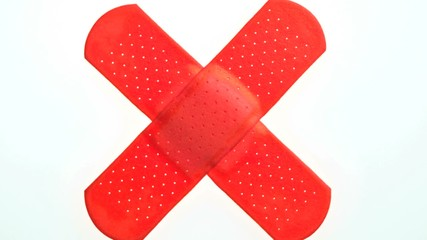 Two Red band-aids in the shape of an X