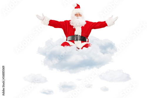 Santa Claus spreading his hands and flying on clouds