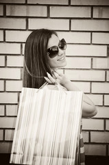 Young brunette with shopping bags
