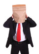 Worrying business man with a paper bag on head
