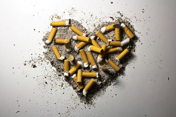 Heart made of smoked cigarettes and ash
