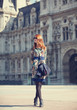 Style girl near retro building in Paris
