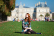 Redhead girl near Luxembourg Palace