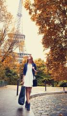 Parisian women at shopping time near Eiffel tower.