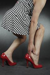 Woman massaging acking feet