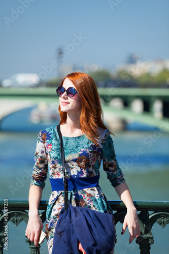 Redhead girl in city