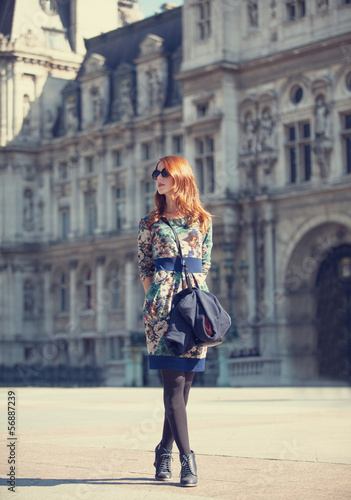 Style girl near retro building in Paris
