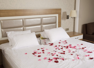 hotel room with big bed and red flowers