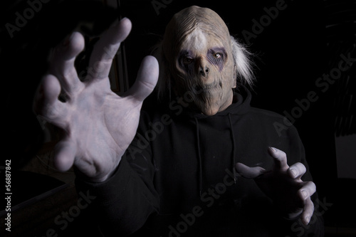 Scary Zombie reaching out to grab someone