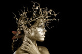 Beautiful Gold Painted Woman in Conceptual Beauty Themed Image