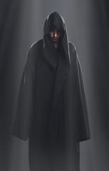 a guy in a black robe standing in the dark