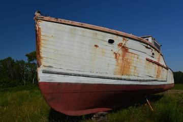 Rotting land bound lobster boat