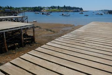 New wooden lobster boat dock low tide