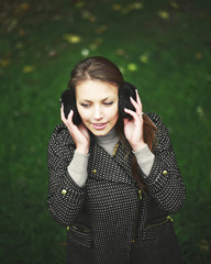young woman in fur headphones