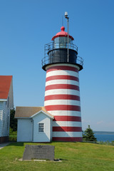 Colorful red and white striped Lighthouse