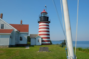 Colorful red and white striped quoddy lighthouse and grounds