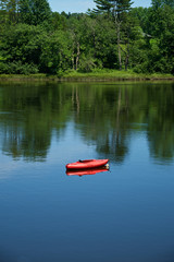 Red kayak in a small calm cove