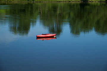 Red Kayak in a calm protective cove in New England