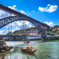 Oporto or Porto skyline, Douro river, boats and bridge. Portugal