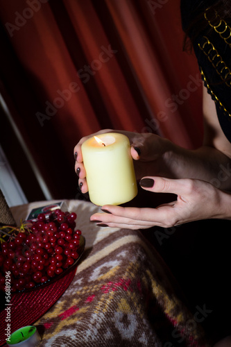 Girl with a candle in hands