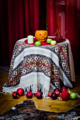 Halloween's table with pumpkin, apples, candles