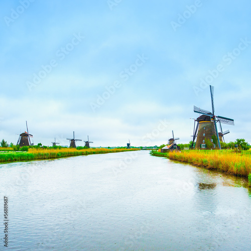 Windmills and canal in Kinderdijk, Holland or Netherlands.