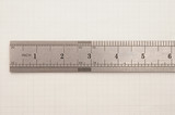 steel ruler on paper graph