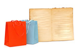 shopping bags and blank old book on white background