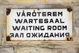Waiting room sign, words on four languages