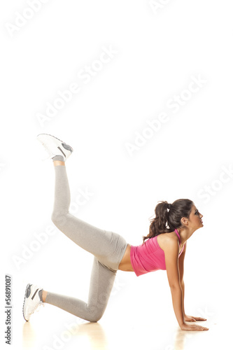 pretty attractive girl shows warm up exercises before training