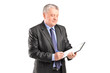 Mature businessman looking at documents
