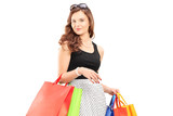 Beautiful young woman posing with shopping bags