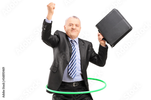 Matue businessman dancing with a hula hoop