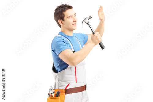Male manual worker working with hammer