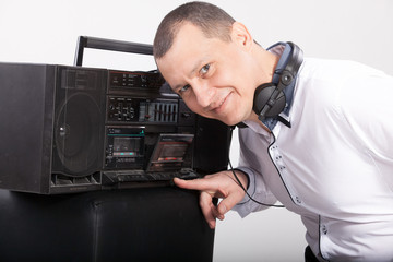 Middleaged man pressing button on retro stereo