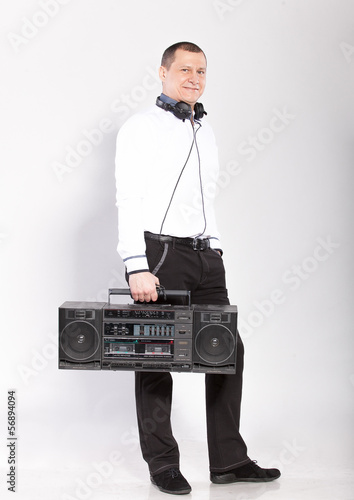 Handsome man posing with old school boombox