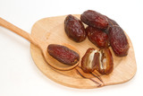 Ripped dates in the wooden plate