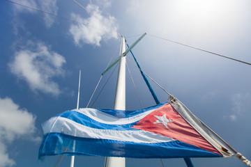 Cuban flag over the sky