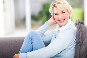 middle aged woman relaxing at home
