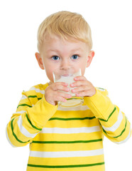 Kid boy drinking yoghurt from glass
