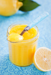 Homemade lemon curd in glass jar, selective focus