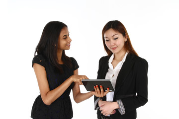 Two happy young Asian business women presenting.
