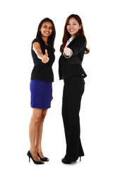 Two happy young Asian business women with thumbs up
