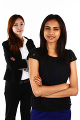 Two happy Asian business women standing together
