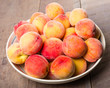 Bowl of fresh yellow peaches