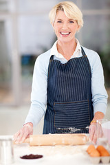 middle aged woman baking in kitchen